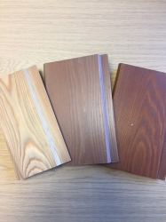 Photo showing three types of cladding in sample sizes.
