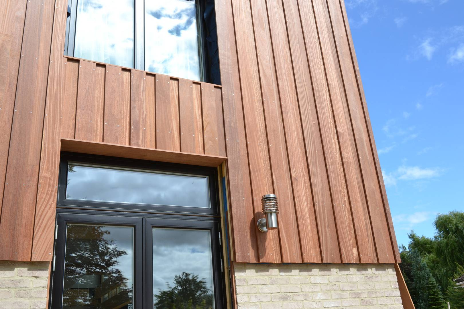 Cumaru Cladding Features On Grand Designs